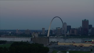 DX0001_000916 - 5.7K stock footage aerial video of the Gateway Arch and the skyline of Downtown St. Louis, Missouri, at twilight