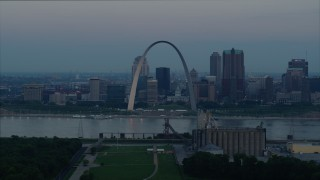 DX0001_000921 - 5.7K stock footage aerial video of the Gateway Arch and the skyline of Downtown St. Louis, Missouri, across the river at sunrise