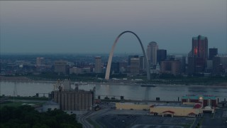 DX0001_000922 - 5.7K stock footage aerial video of the Gateway Arch in Downtown St. Louis, Missouri, across the Mississippi River at sunrise