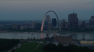 DX0001_000924 - 5.7K stock footage aerial video of the Gateway Arch and Downtown St. Louis, Missouri, beside the Mississippi River at sunrise