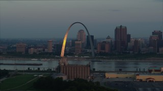 DX0001_000931 - 5.7K stock footage aerial video of sunlight reflected off the Gateway Arch in Downtown St. Louis, Missouri, at sunrise