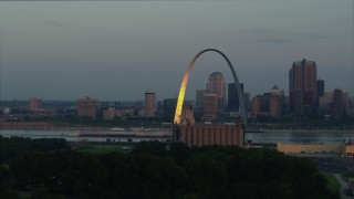 DX0001_000934 - 5.7K stock footage aerial video the Gateway Arch reflecting bright morning sunlight in Downtown St. Louis, Missouri