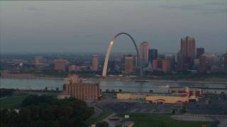 DX0001_000940 - 5.7K stock footage aerial video of sunlight on the St. Louis Arch by the Mississippi River at sunrise in Downtown St. Louis, Missouri