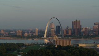 DX0001_000953 - 5.7K stock footage aerial video of morning sunlight reflecting off the Gateway Arch in Downtown St. Louis, Missouri