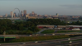 DX0001_000957 - 5.7K stock footage aerial video pan across I-55 to reveal the Gateway Arch in the morning, Downtown St. Louis, Missouri