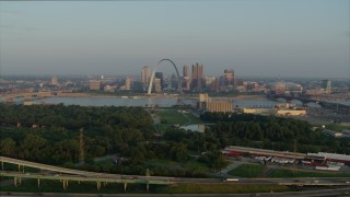 DX0001_000958 - 5.7K stock footage aerial video a reverse view of the Gateway Arch in the morning, reveal I-55, Downtown St. Louis, Missouri