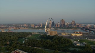 DX0001_000962 - 5.7K stock footage aerial video flyby grain elevator with view of the Gateway Arch in the morning, Downtown St. Louis, Missouri