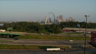 DX0001_000970 - 5.7K stock footage aerial video ascend from light traffic on I-55 for view of the Gateway Arch at sunrise, Downtown St. Louis, Missouri