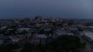 DX0001_000974 - 5.7K stock footage aerial video of flying by the city skyline at twilight in Downtown Kansas City, Missouri