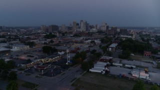 DX0001_000976 - 5.7K stock footage aerial video of the city skyline at twilight, seen from industrial area in Downtown Kansas City, Missouri
