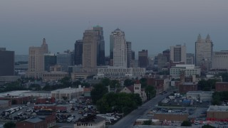 DX0001_000983 - 5.7K stock footage aerial video of passing the city's tall skyscrapers at twilight in Downtown Kansas City, Missouri