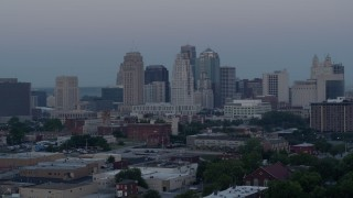 DX0001_000984 - 5.7K stock footage aerial video of the city's tall skyscrapers at twilight in Downtown Kansas City, Missouri