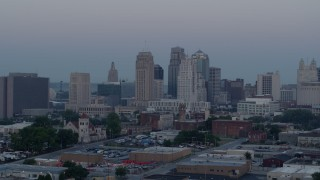 DX0001_000985 - 5.7K stock footage aerial video flyby the city's tall skyscrapers at twilight in Downtown Kansas City, Missouri