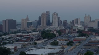 DX0001_000986 - 5.7K stock footage aerial video of a reverse view of the city's tall skyscrapers at twilight in Downtown Kansas City, Missouri