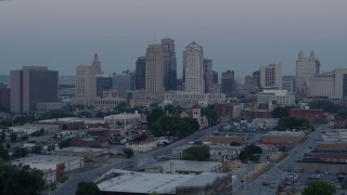 DX0001_000987 - 5.7K stock footage aerial video of a slow approach to the city's tall skyscrapers at twilight in Downtown Kansas City, Missouri