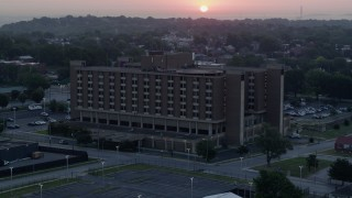 DX0001_000989 - 5.7K stock footage aerial video of approaching a brick office building at sunrise in Kansas City, Missouri