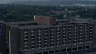 DX0001_000992 - 5.7K stock footage aerial video of circling around a brick office building at sunrise in Kansas City, Missouri
