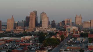 DX0001_000995 - 5.7K stock footage aerial video of flying by the city skyline at sunrise, Downtown Kansas City, Missouri