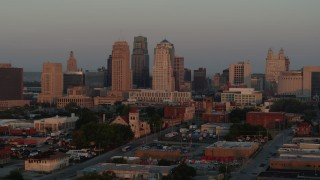 DX0001_000996 - 5.7K stock footage aerial video of approaching the city skyline at sunrise, Downtown Kansas City, Missouri