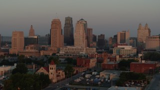 DX0001_000997 - 5.7K stock footage aerial video slow approach and stationary view of the city skyline at sunrise, Downtown Kansas City, Missouri