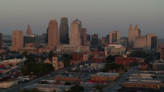 DX0001_000999 - 5.7K stock footage aerial video fly to stationary view of the city skyline at sunrise, Downtown Kansas City, Missouri