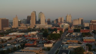 DX0001_001003 - 5.7K stock footage aerial video of flying by the city skyline at sunrise, Downtown Kansas City, Missouri