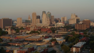 DX0001_001004 - 5.7K stock footage aerial video flyby the city skyline at sunrise, Downtown Kansas City, Missouri