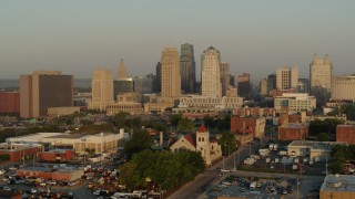 DX0001_001011 - 5.7K stock footage aerial video approach the city skyline at sunrise from east of the city, pause for static view, Downtown Kansas City, Missouri