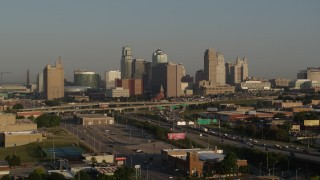 DX0001_001017 - 5.7K stock footage aerial video of the downtown skyline at sunrise and freeway interchange, Downtown Kansas City, Missouri
