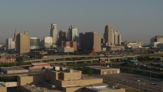 DX0001_001020 - 5.7K stock footage aerial video approach the downtown skyline and Hwy 71 at sunrise, Downtown Kansas City, Missouri