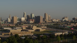 DX0001_001022 - 5.7K stock footage aerial video reverse view of the downtown skyline at sunrise, Downtown Kansas City, Missouri