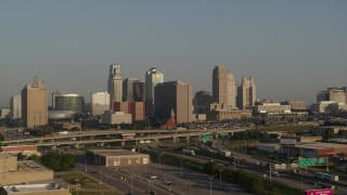 DX0001_001024 - 5.7K stock footage aerial video of a side view of the downtown skyline and freeway interchange at sunrise, Downtown Kansas City, Missouri