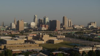 DX0001_001026 - 5.7K stock footage aerial video flyby the downtown skyline at sunrise, seen from tech school in Downtown Kansas City, Missouri