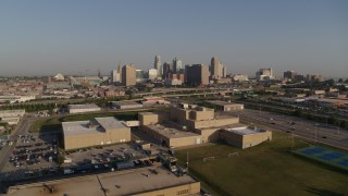 DX0001_001035 - 5.7K stock footage aerial video a static and reverse view of tech school and the city skyline of Downtown Kansas City, Missouri
