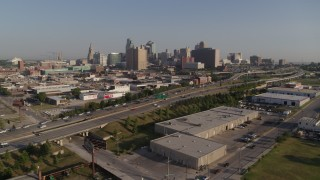 DX0001_001038 - 5.7K stock footage aerial video flyby a freeway east of city office buildings in Downtown Kansas City, Missouri