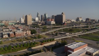 DX0001_001039 - 5.7K stock footage aerial video flyby a freeway east of city office buildings to interchange in Downtown Kansas City, Missouri