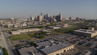 DX0001_001041 - 5.7K stock footage aerial video reverse view of freeway and city skyline in Downtown Kansas City, Missouri