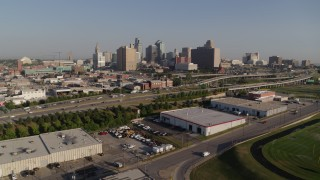 DX0001_001042 - 5.7K stock footage aerial video approach freeway and city skyline in Downtown Kansas City, Missouri