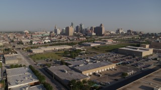 DX0001_001045 - 5.7K stock footage aerial video of approaching warehouse buildings, freeway and skyline of Downtown Kansas City, Missouri