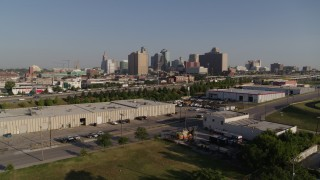 DX0001_001046 - 5.7K stock footage aerial video of descend toward warehouse buildings, freeway near skyline of Downtown Kansas City, Missouri