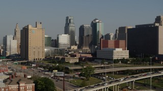 DX0001_001050 - 5.7K stock footage aerial video stationary view of a city office building and skyscrapers in Downtown Kansas City, Missouri