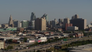 DX0001_001059 - 5.7K stock footage aerial video flyby the city's skyline from east of the freeway in Downtown Kansas City, Missouri