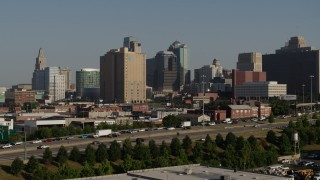 DX0001_001061 - 5.7K stock footage aerial video of downtown high-rises seen while descending near freeway in Downtown Kansas City, Missouri