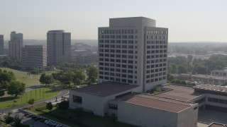 DX0001_001064 - 5.7K stock footage aerial video of circling around an office building in Kansas City, Missouri