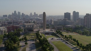 DX0001_001068 - 5.7K stock footage aerial video orbit the WWI memorial in Kansas City, Missouri, with a view of the downtown skyline