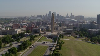 DX0001_001069 - 5.7K stock footage aerial video circle the WWI memorial in Kansas City, Missouri, with a view of the downtown skyline