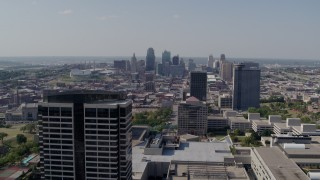 DX0001_001086 - 5.7K stock footage aerial video of the city skyline behind tall Crown Center office buildings, Downtown Kansas City, Missouri