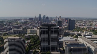 DX0001_001088 - 5.7K stock footage aerial video static view of city skyline behind Crown Center office building, Downtown Kansas City, Missouri