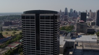 DX0001_001094 - 5.7K stock footage aerial video of orbiting a Crown Center office building in Kansas City, Missouri