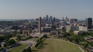 DX0001_001103 - 5.7K stock footage aerial video pass by the WWI memorial for view of Downtown Kansas City, Missouri skyline